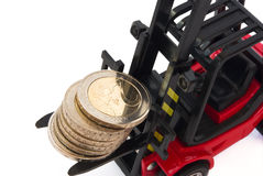 Stack of 2 Euro coins on forklift Royalty Free Stock Photo