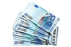 A stack of 20 Euro notes. A stack of 20 Euro currency bank notes, isolated on a white background royalty free stock photos