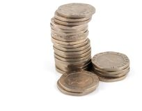 Stack of 20 Pence Pieces. Stacks of Money on a white Background Royalty Free Stock Photos