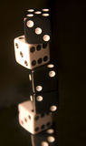 A Stack of 3 Dice. On reflective surface Royalty Free Stock Photo