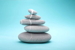 Stack of 5 rocks. Onthe blue bckground Royalty Free Stock Photos