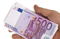 Stack of 500 euro in hand. On the white background Royalty Free Stock Photo
