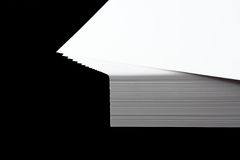 Stack of  A4 paper. Spread out stack of A4 printing paper on black Stock Photo