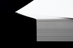 Stack of A4 paper. Spread out stack of A4 printing paper on black royalty free stock photo