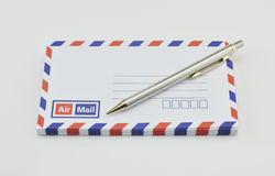 Stack of air mail envelopes with pen Stock Images