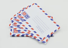 Stack of air mail envelopes on white Stock Photography