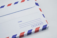 Stack of air mail envelopes on white Stock Image