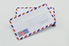 Stack of air mail envelopes on white Royalty Free Stock Image