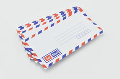 Stack of air mail envelopes on white Stock Photo