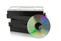 Stack of analog video cassettes with DVD disc Stock Photos
