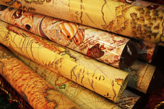 Stack of ancient map gift wrapping. A stack of gift wrapping paper with ancient map drawing on it.A stack of gift wrapping paper with ancient map drawing on it Royalty Free Stock Photo