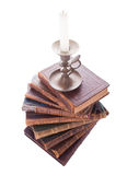 Stack antique books and candlestick. Stack of six antique books, isolated white background Stock Image