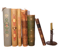 Stack antique books and candlestick. Stack of nine antique books, isolated white background Stock Images