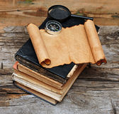 Stack of antique books with compass Royalty Free Stock Image