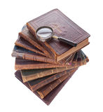 Stack antique books and  magnifier. Stack of nine antique books, isolated white background Stock Photography