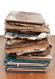 Stack antique books on wooden table Royalty Free Stock Photos