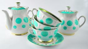 Stack of antique ceramic cups on a saucer, teapots stock image