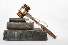 Stack of Antique Worn Leather Bibles with Gavel and Glasses on W Royalty Free Stock Image