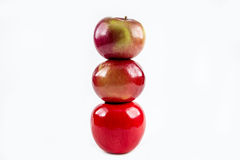A stack of Apples. A trio of apples stacked against a white background Royalty Free Stock Images
