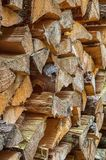 Sorted wood log background texture. Stack of arranged brown wood log background Royalty Free Stock Images
