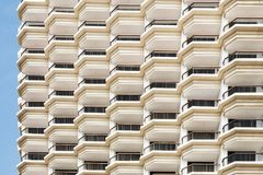 Stack array many floor and terrace hotel building Stock Image