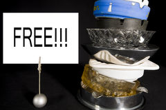 Stack of Ashtrays with 'Free' Sign Royalty Free Stock Photo