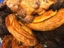 Stack of Assorted Breakfast Pastries. Closeup of pastries including croissants and other breakfast baked treats stock images
