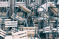 Wooden chairs in random disarray. Stack of assorted metal and wooden chairs in random disarray, Wooden chairs. Pile of chairs. wooden seats stock images