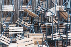 Wooden chairs in random disarray. Stack of assorted metal and wooden chairs in random disarray, Wooden chairs. Pile of chairs. wooden seats royalty free stock photos