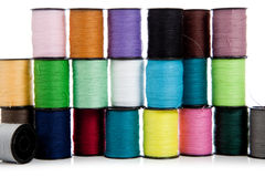 Stack of assorted threads on a white background Royalty Free Stock Photos