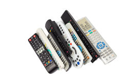 Stack of audio video remote control device in white background Stock Image