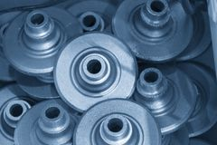The stack of automotive casting part. In the light blue scene Royalty Free Stock Image