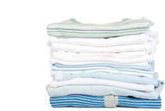 A stack of baby clothes