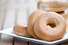 stack of bagel on white plate Stock Photography