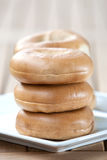 Stack of bagel on white plate Stock Photos
