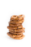 A stack of baked pretzels on white. Close up photography of 1 stack of baked pretzels on white royalty free stock photography