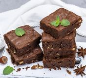 Stack of baked square pieces of brownie pie Royalty Free Stock Photo