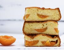 A stack of baked square slices of a biscuit pie with apricots Stock Photography