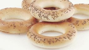Sugar bagels with poppy seeds. A stack of bakery products. Wheat flour from the highest grade Sugar bread with poppy Kiev stock video footage