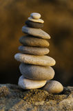 Stack of balanced pebbles in sunset light Royalty Free Stock Image