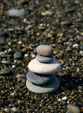 Stack of balanced stones. Or pebbles on shingle beach Royalty Free Stock Images