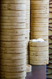 Stack of bamboo rice steamers royalty free stock image