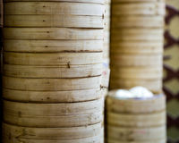 Stack of bamboo rice steamers Stock Image