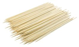 Stack of Bamboo Skewers on White Background. Kitchen Utensils, Pile of Wooden Sticks or Bamboo Skewers Used to Hold Pieces of Food Together Royalty Free Stock Photo