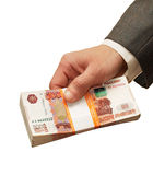 Stack of banknotes. In a man's hand Royalty Free Stock Photos