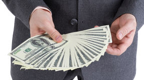 Stack banknotes of 100 dollars in male hands Stock Photo