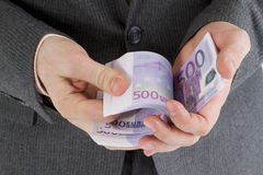 Stack banknotes euro in his hand Stock Photo