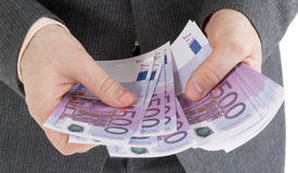 Stack banknotes of 500 euro in male hands Royalty Free Stock Images