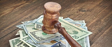 Stack Of Banknotes With Judges Or Auctioneers Gavel Or Hammer. Stack Of Dollar Banknotes With Judges Or Auctioneers Gavel Or Hammer, Trial Or Tribunal Concept royalty free stock photos