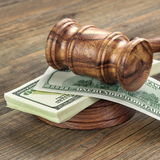 Stack Of Banknotes With Judges Or Auctioneers Gavel Or Hammer. Stack Of Dollar Banknotes With Judges Or Auctioneers Gavel Or Hammer, Trial Or Tribunal Concept royalty free stock image